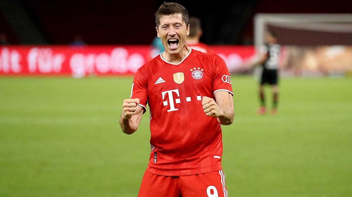 Robert Lewandowski of Bayern Muenchen celebrates scoring the 4th team goal during the DFB Cup final match between Bayer 04 Leverkusen and FC Bayern Muenchen