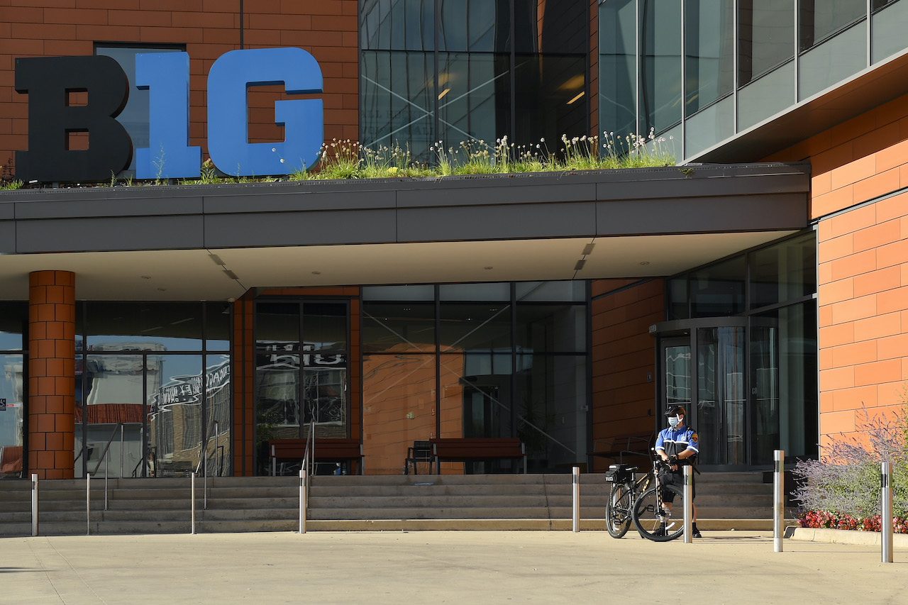 A bike cop stands outside B1G Ten headquarters in Illinois during a small protest by parents demanding a football season, in April.