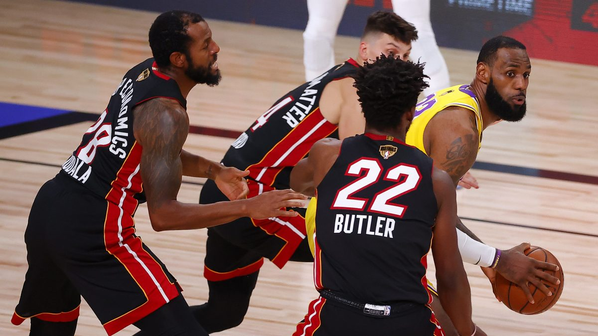 Several Heat players ineffectually harass LeBron James.
