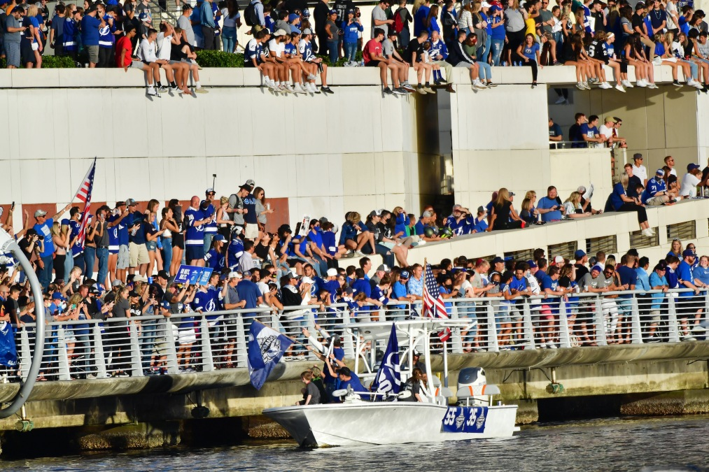 TAMPA, FLORIDA - SEPTEMBER 30: Braydon Coburn #55 and Curtis McElhinney #35 of the Tampa Bay Lightning wave to fans at the Tampa Bay Lightning Victory Rally & Boat Parade on the Hillsborough river on September 30, 2020 in Tampa, Florida. (Photo by Julio Aguilar/Getty Images)