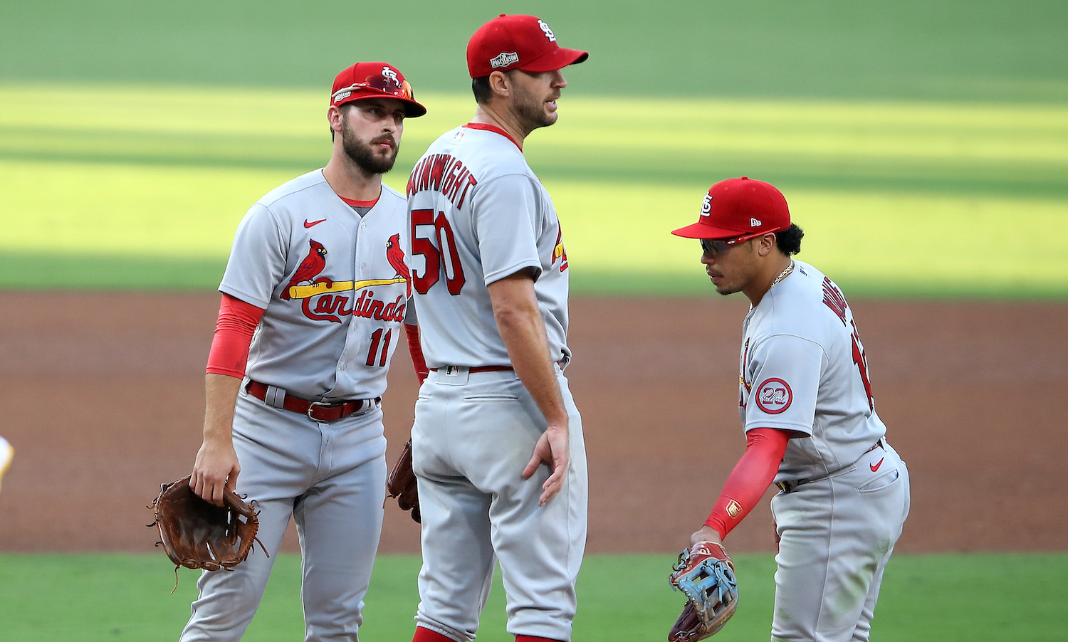 SAN DIEGO, CALIFORNIA - OCTOBER 01: Paul DeJong #11, and Kolten Wong #16 talk with Adam Wainwright #50 of the St. Louis Cardinals as he was being pulled from the game as Wil Myers #4 of the San Diego Padres walks to third base during the fourth inning of Game Two of the National League Wild Card Series at PETCO Park on October 01, 2020 in San Diego, California. (Photo by Sean M. Haffey/Getty Images)