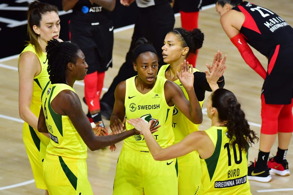 Breanna Stewart #30, Natasha Howard #6, Jewell Loyd #24, Alysha Clark #32, and Sue Bird #10 of the Seattle Storm meet after a foul during the first half of Game Two of the WNBA Finals against the Las Vegas Aces at Feld Entertainment Center on October 04, 2020 in Palmetto, Florida.