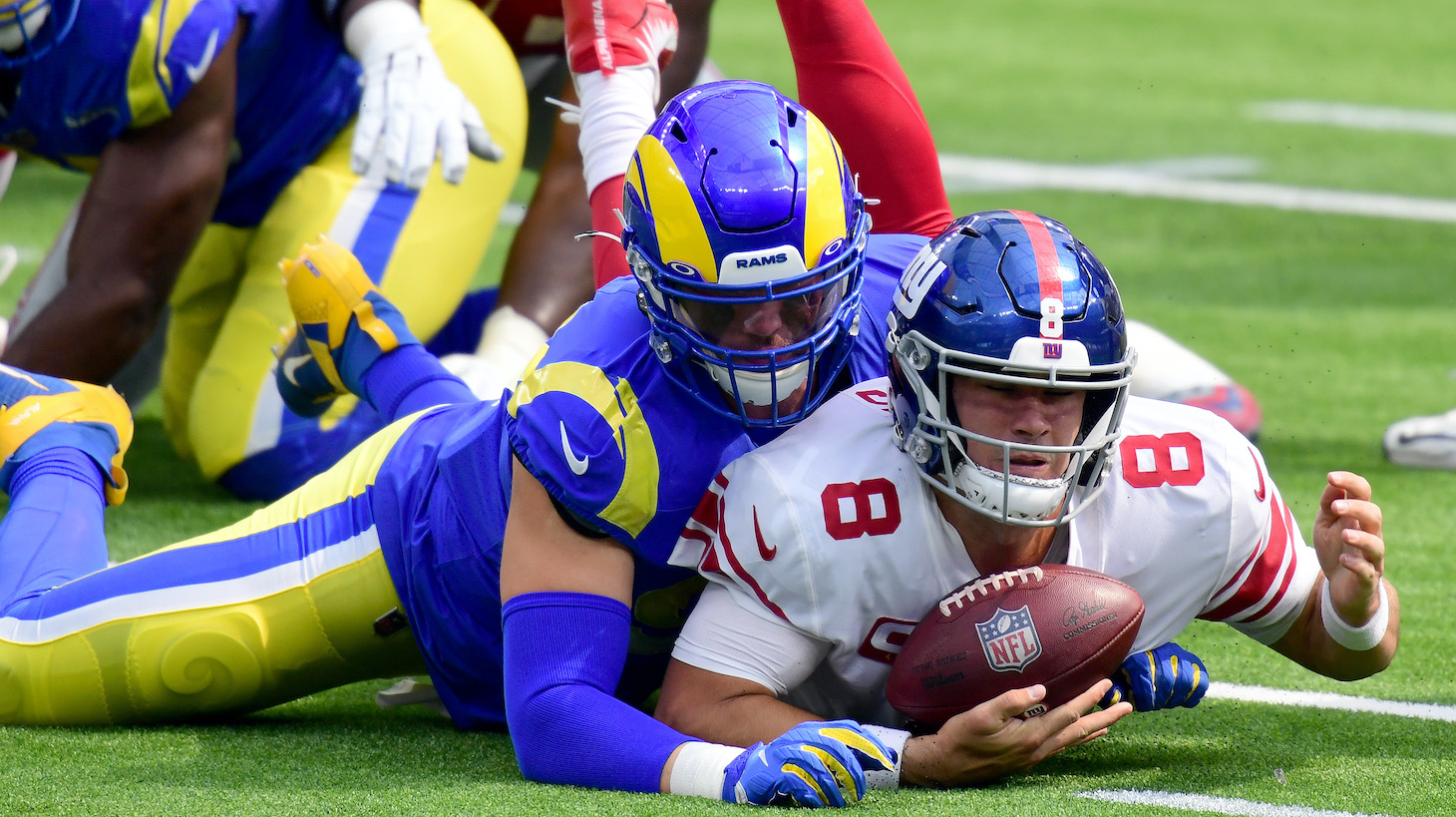 INGLEWOOD, CALIFORNIA - OCTOBER 04: Daniel Jones #8 of the New York Giants recovers his fumble as he is sacked by Morgan Fox #97 of the Los Angeles Rams during the first half at SoFi Stadium on October 04, 2020 in Inglewood, California. (Photo by Harry How/Getty Images)
