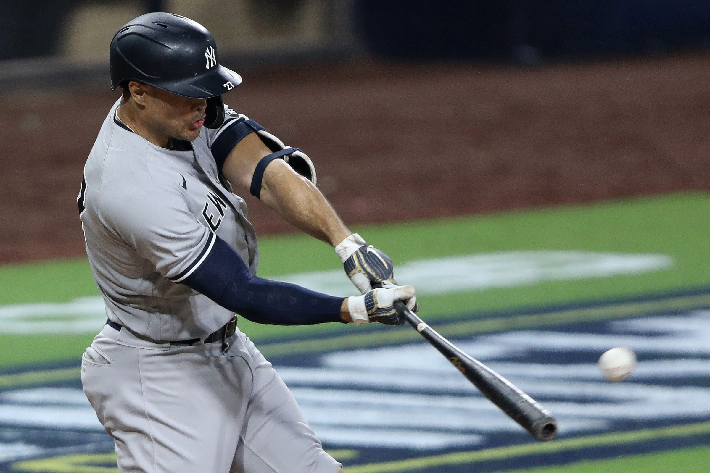 Giancarlo Stanton #27 of the New York Yankees hits a grand slam