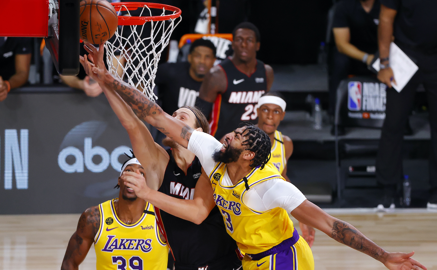 LAKE BUENA VISTA, FLORIDA - OCTOBER 06: Anthony Davis #3 of the Los Angeles Lakers blocks Kelly Olynyk #9 of the Miami Heat during the second quarter in Game Four of the 2020 NBA Finals at AdventHealth Arena at the ESPN Wide World Of Sports Complex on October 6, 2020 in Lake Buena Vista, Florida. NOTE TO USER: User expressly acknowledges and agrees that, by downloading and or using this photograph, User is consenting to the terms and conditions of the Getty Images License Agreement. (Photo by Kevin C. Cox/Getty Images)