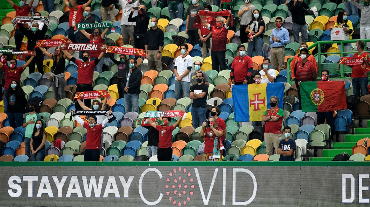 Portuguese fans wearing masks await the kick off during the international friendly match between Portugal and Spain at Estadio Jose Alvalade on October 07, 2020 in Lisbon, Portugal.