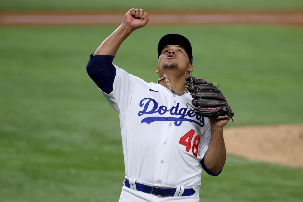 Brusdar Graterol #48 of the Los Angeles Dodgers celebrates as he walks to the dugout