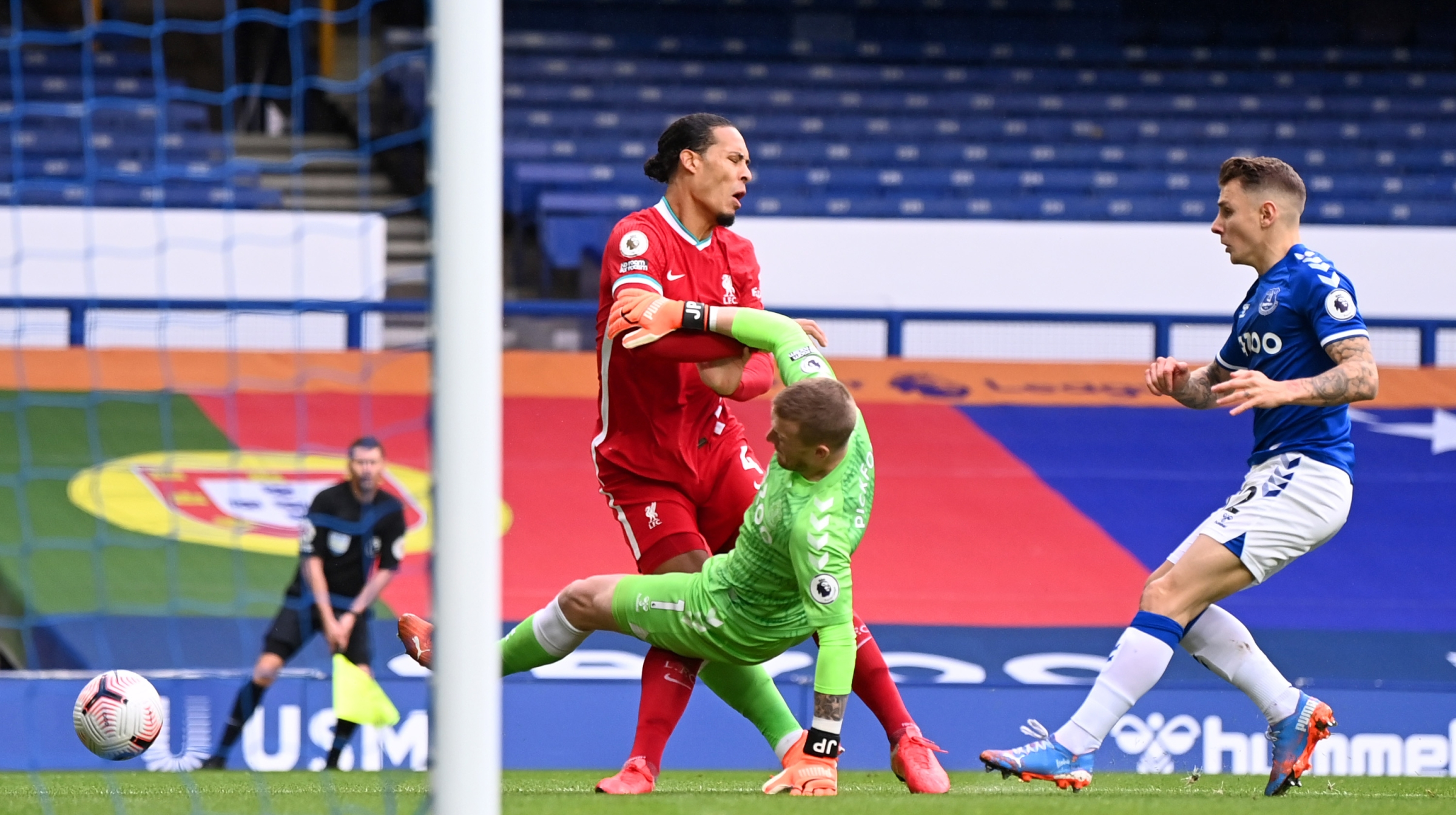 Virgil van Dijk of Liverpool is tackled by Jordan Pickford of Everton which led to Virgil van Dijk being substituted for an injury during the Premier League match between Everton and Liverpool
