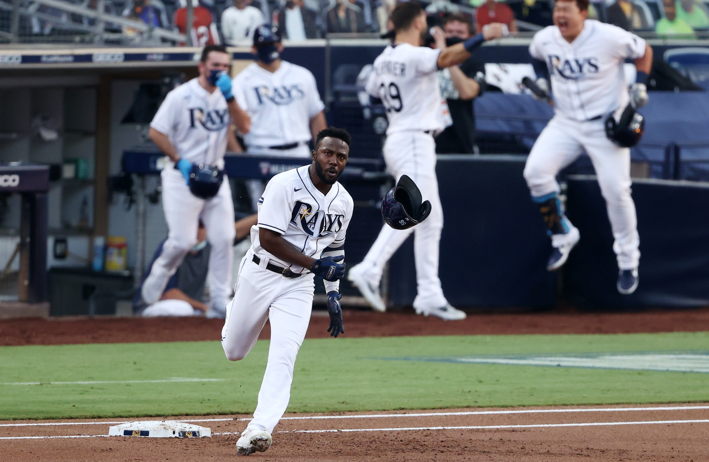 Randy Arozarena of the Tampa Bay Rays rounds the bases after hitting a home run in Game 7 of the ALCS