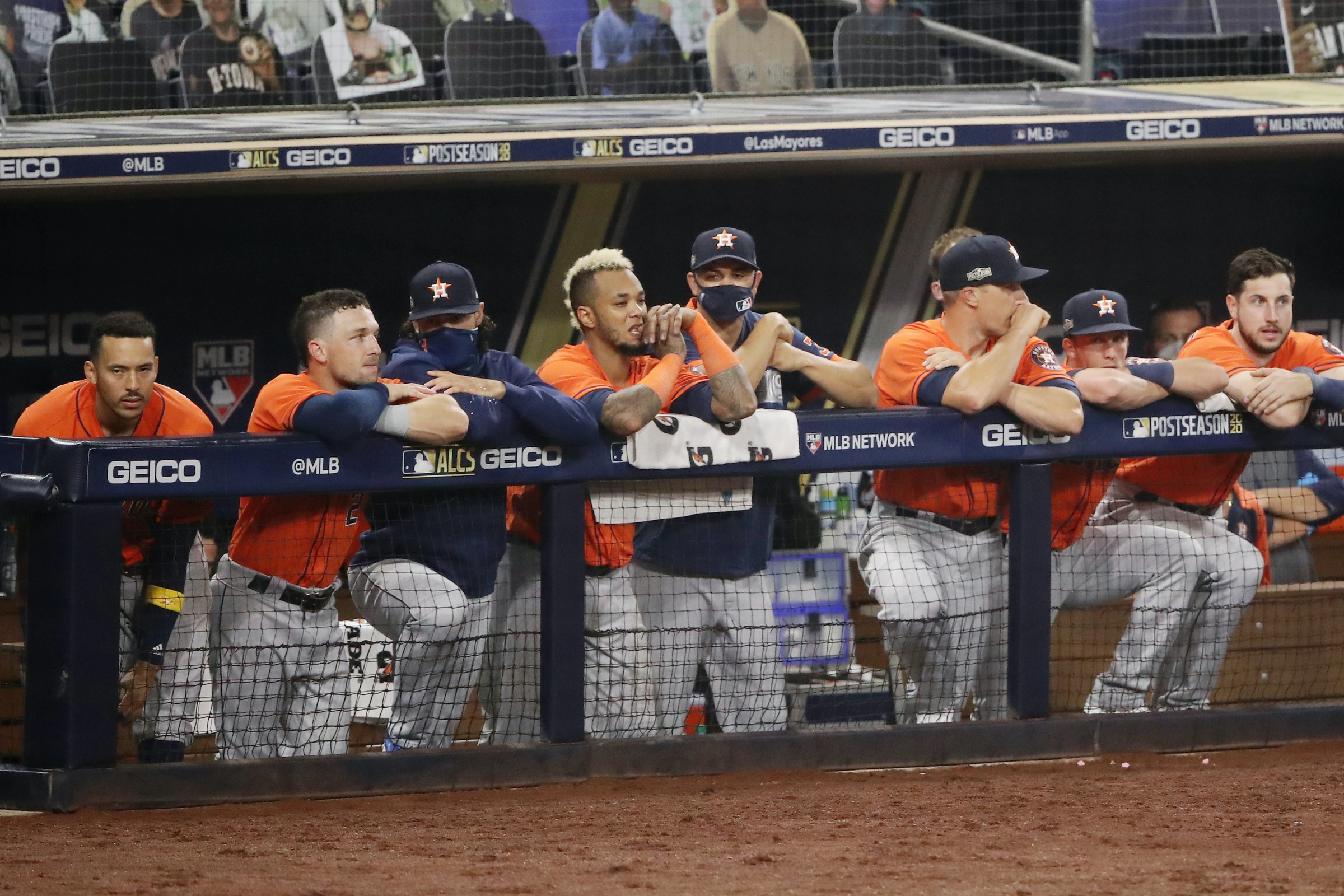 Houston Astros players sit in the dugout during Game 7 of the ALCS.
