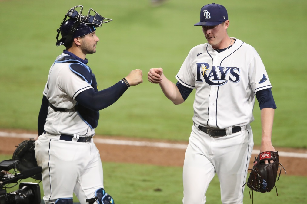 Mike Zunino congratulates Peter Fairbanks, one of the Rays' 23 excellent relievers.
