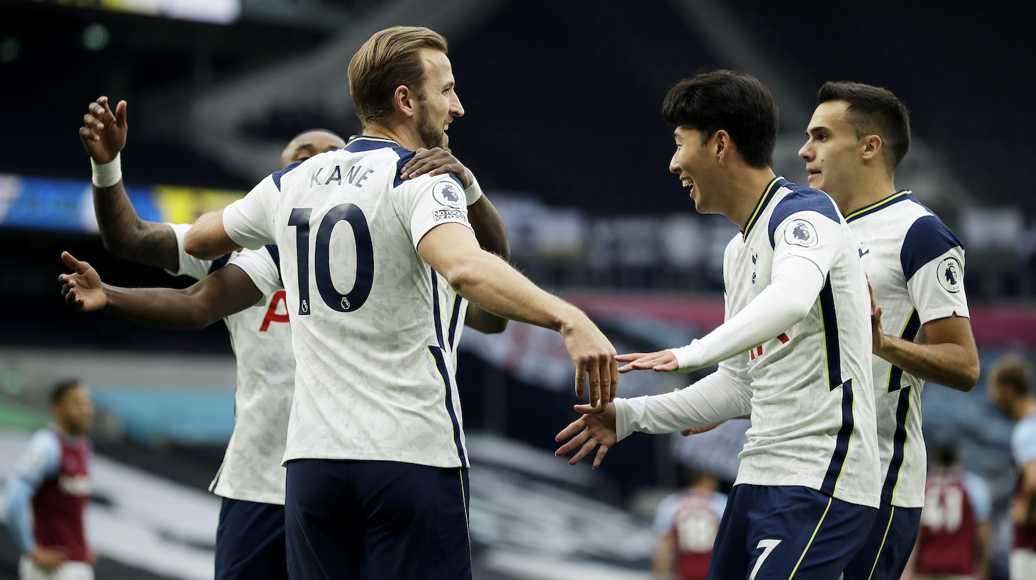 Harry Kane of Tottenham Hotspur celebrates with teammates after scoring his team's second goal during the Premier League match between Tottenham Hotspur and West Ham United at Tottenham Hotspur Stadium on October 18, 2020 in London, England. Sporting stadiums around the UK remain under strict restrictions due to the Coronavirus Pandemic as Government social distancing laws prohibit fans inside venues resulting in games being played behind closed doors.