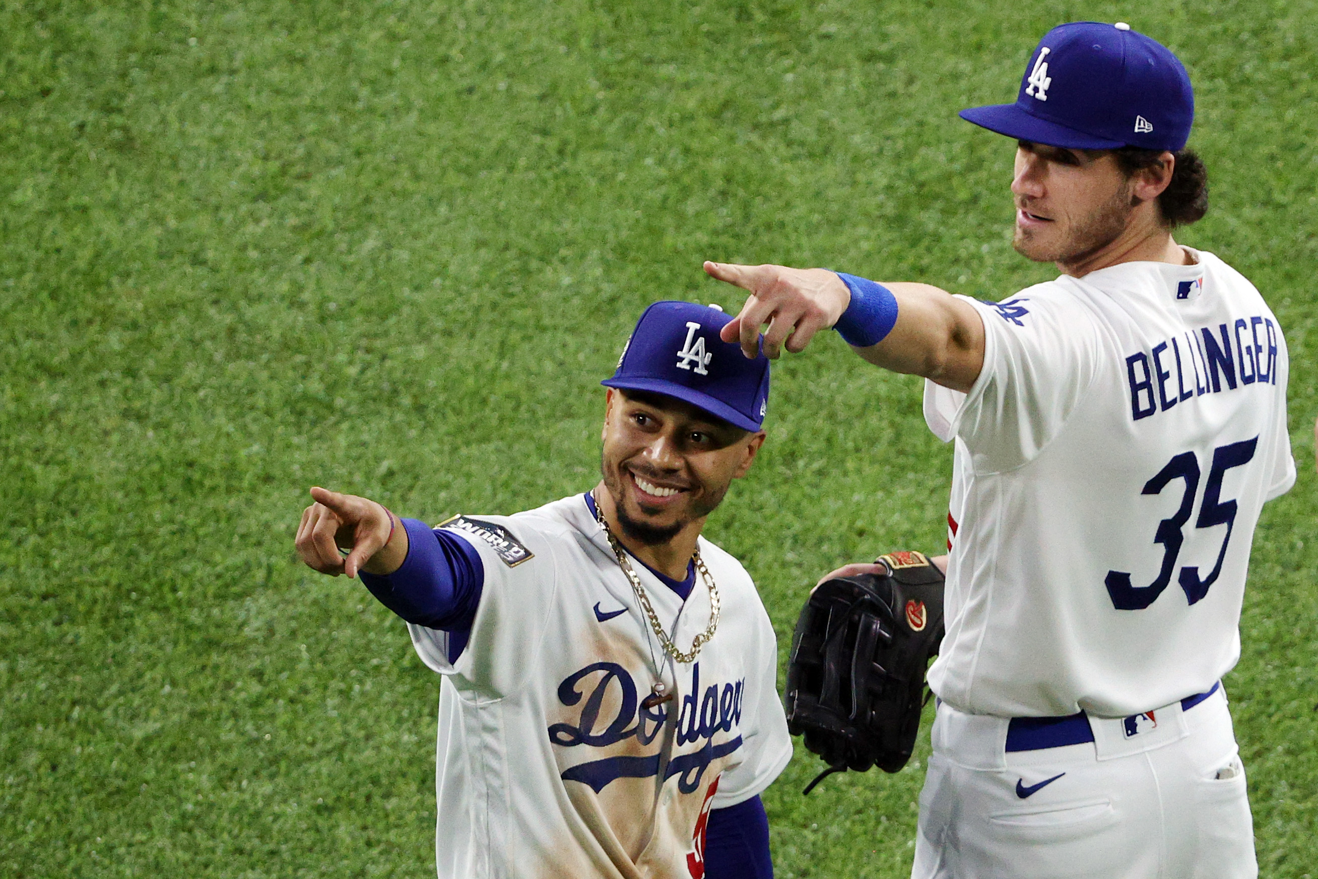 Cody Bellinger #35 and Mookie Betts #50 of the Los Angeles Dodgers celebrate