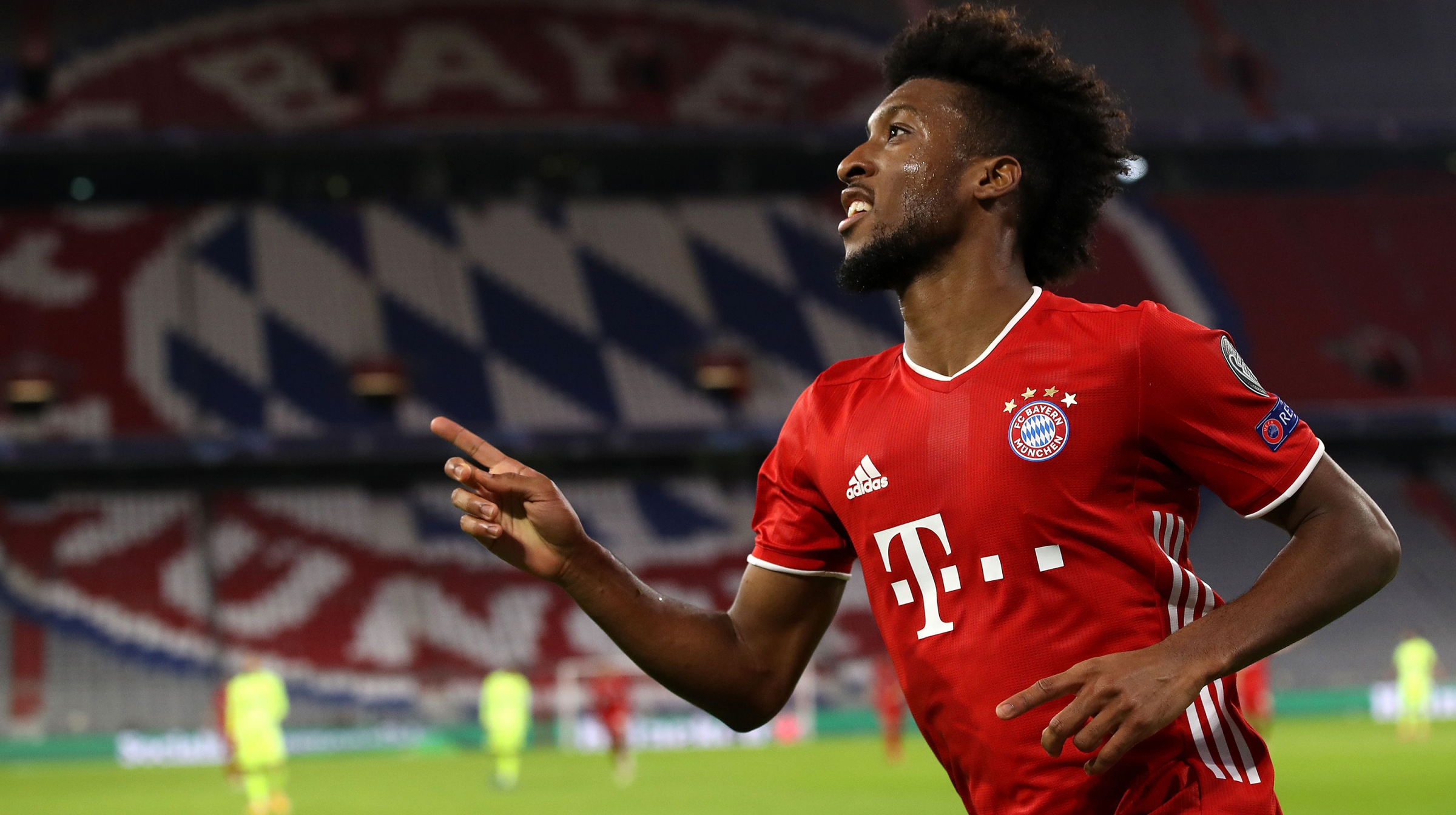 Kingsley Coman of FC Bayern München celebrates scoring the 4th team goal during the UEFA Champions League Group A stage match between FC Bayern Muenchen and Atletico Madrid