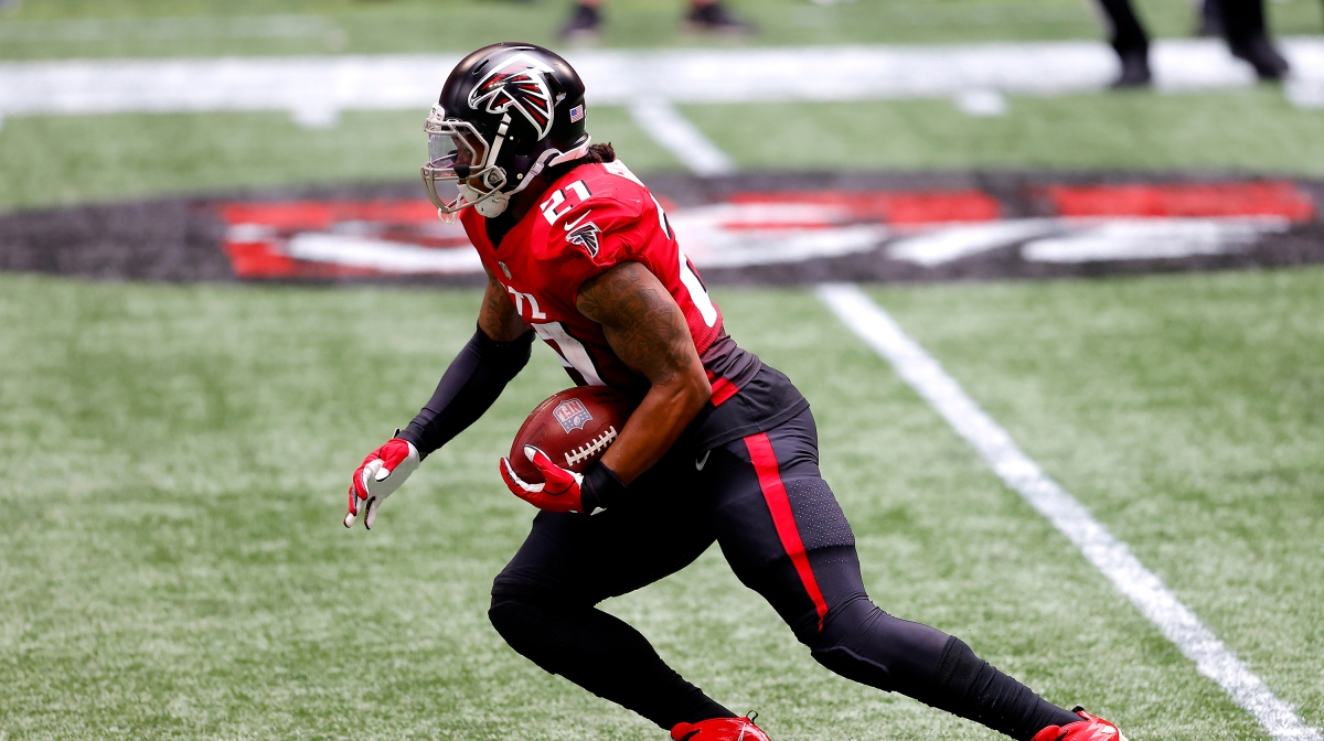 Todd Gurley II #21 of the Atlanta Falcons carries the ball after a reception against the Detroit Lions during the first half at Mercedes-Benz Stadium on October 25, 2020