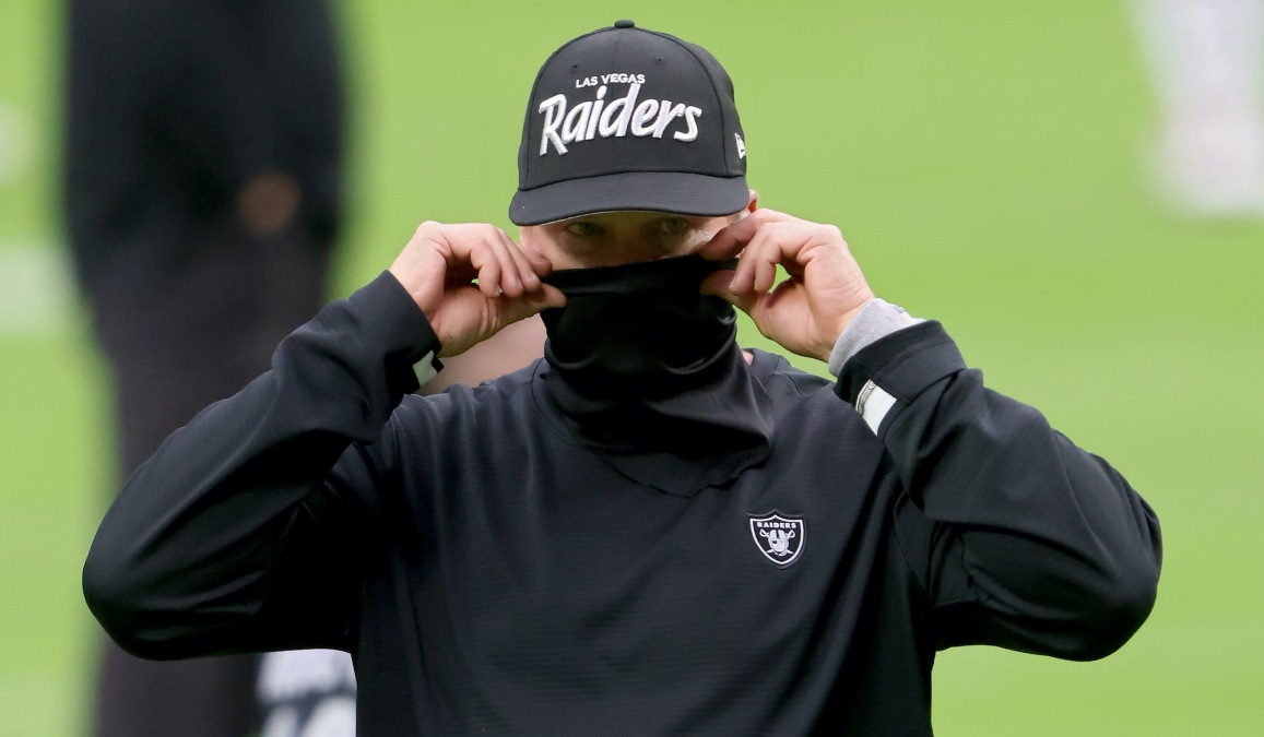 LAS VEGAS, NEVADA - OCTOBER 25: Head coach Jon Gruden of the Las Vegas Raiders walks across the field before the game against the Tampa Bay Buccaneers at Allegiant Stadium on October 25, 2020 in Las Vegas, Nevada. (Photo by Jamie Squire/Getty Images)