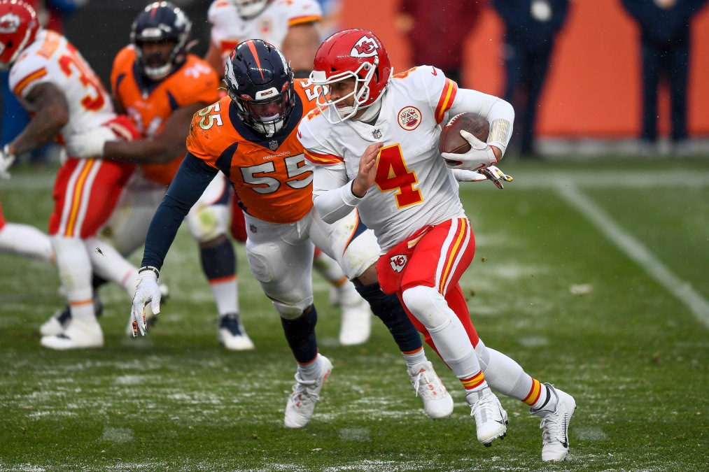 Chad Henne of the Kansas City Chiefs runs for a touchdown in the year 2020