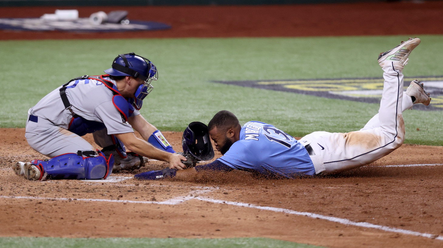 ARLINGTON, TEXAS - OCTOBER 25: Manuel Margot #13 of the Tampa Bay Rays is tagged out by Austin Barnes #15 of the Los Angeles Dodgers on an attempt to steal home during the fourth inning in Game Five of the 2020 MLB World Series at Globe Life Field on October 25, 2020 in Arlington, Texas. (Photo by Tom Pennington/Getty Images)