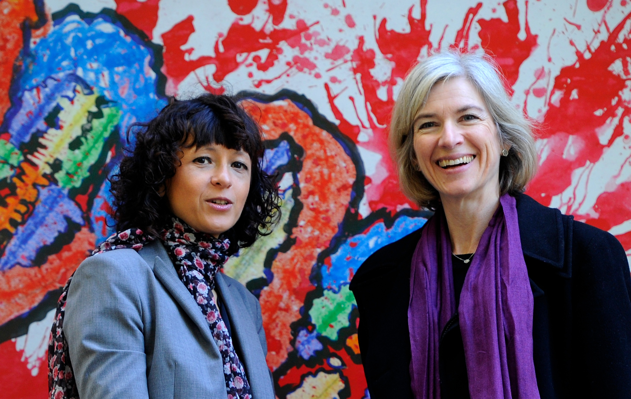 French researcher in Microbiology, Genetics and Biochemistry Emmanuelle Charpentier (L) and US professor of Chemistry and of Molecular and Cell Biology, Jennifer Doudna pose beside a painting made by children of the genome at the San Francisco park in Oviedo, on October 21, 2015.