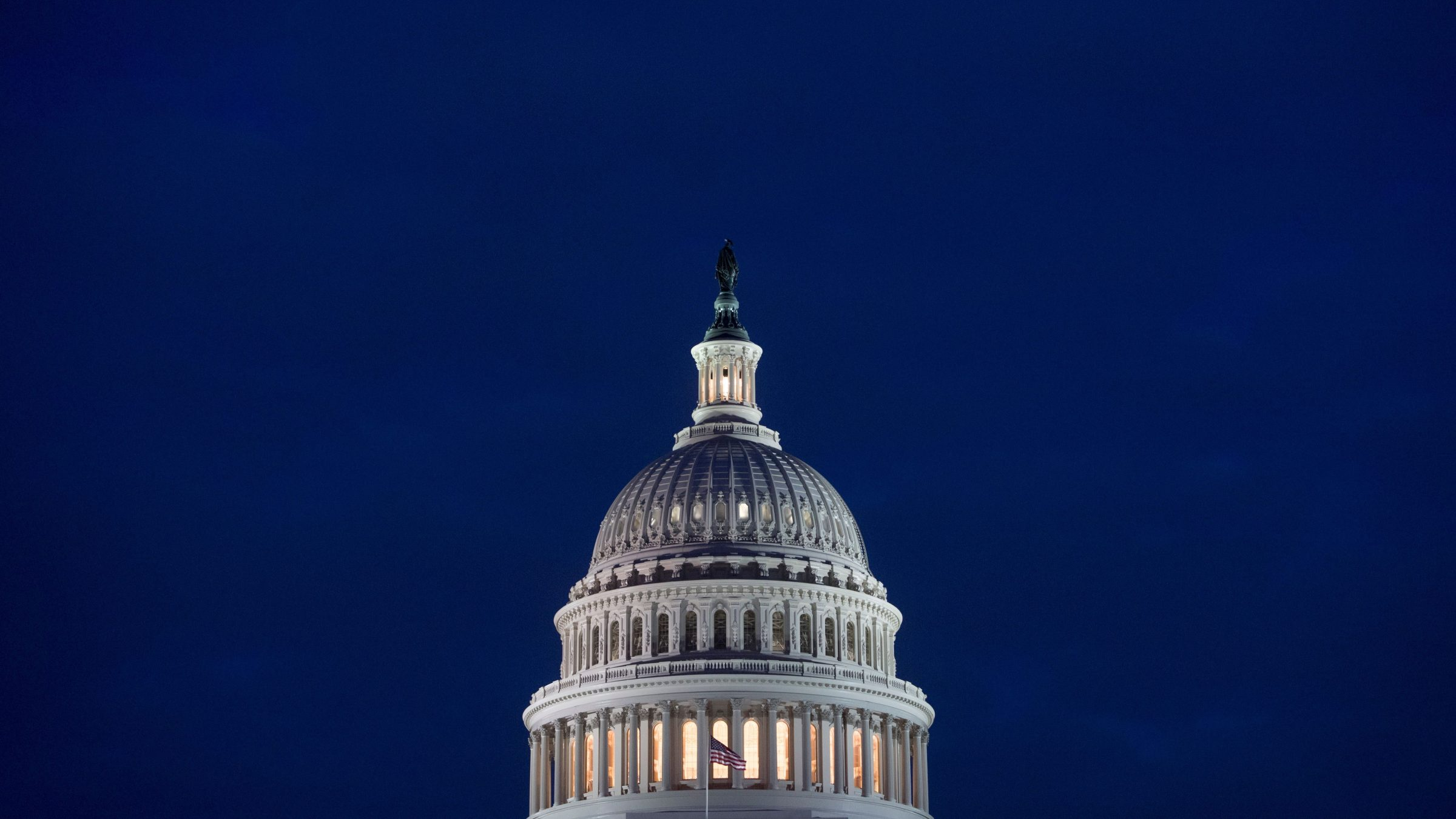 The US Capitol Building is seen at dusk in Washington, DC.