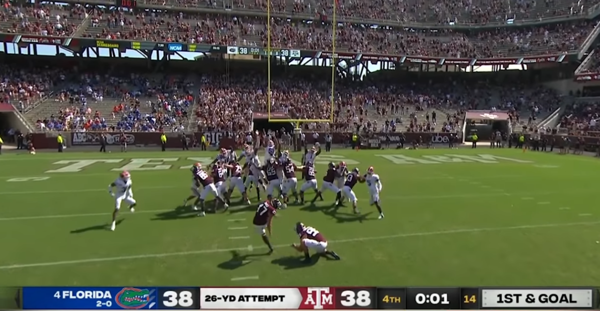 Texas A&M attempts a field goal against Florida in front of a crowd of 24,709