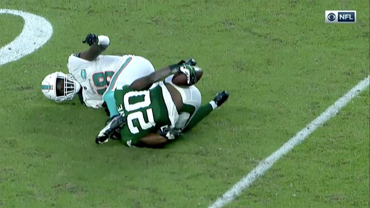 Marcus Maye of the New York Jets intercepts a ball by holding it against his butt.