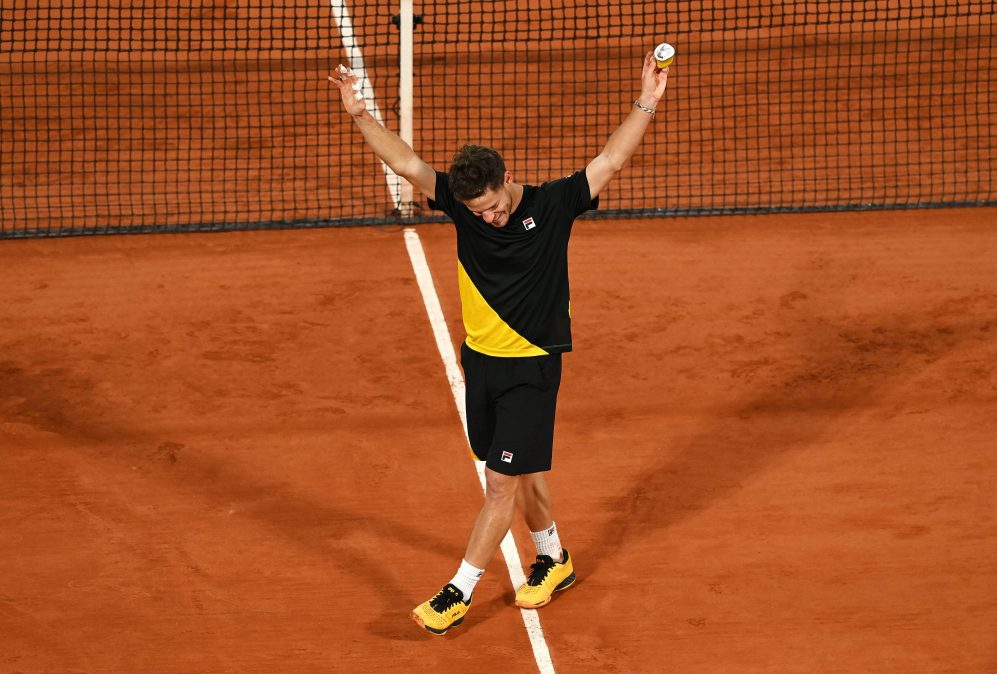 Diego Schwartzman celebrates on court after his French Open quarterfinal win.