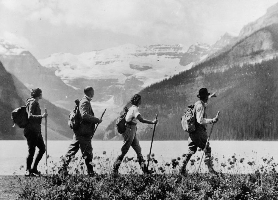 Hikers stroll past lake