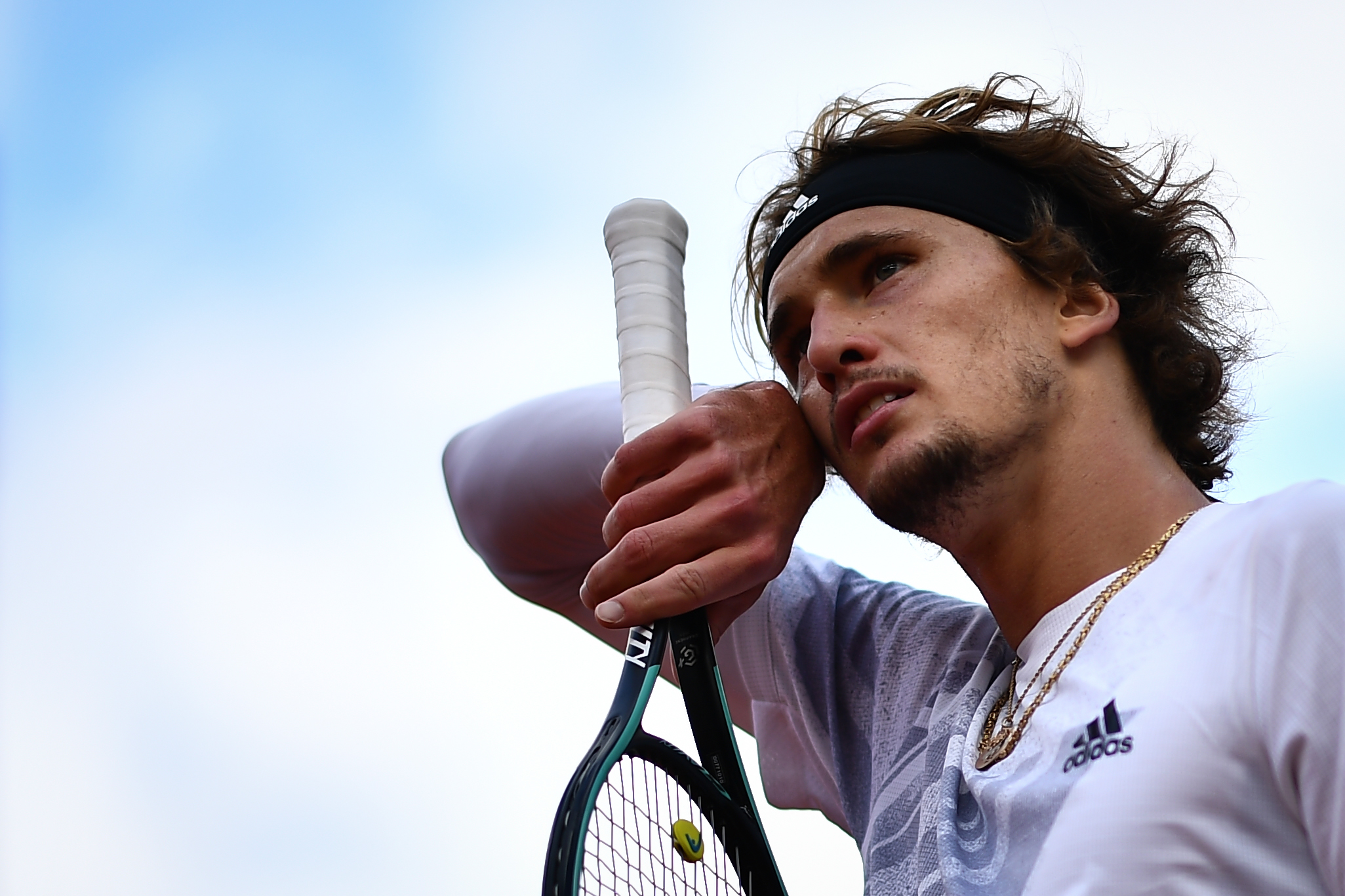 Sascha Zverev wipes his face during his French Open loss to Jannik Sinner.