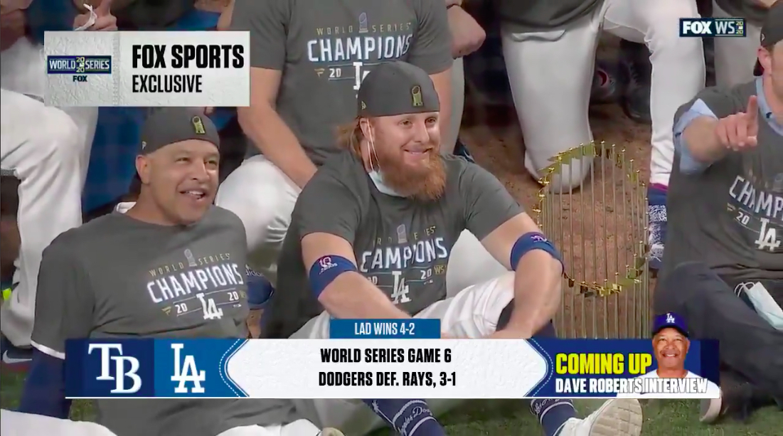 Justin Turner of the Dodgers sits for team photo after testing positive for coronavirus midgame
