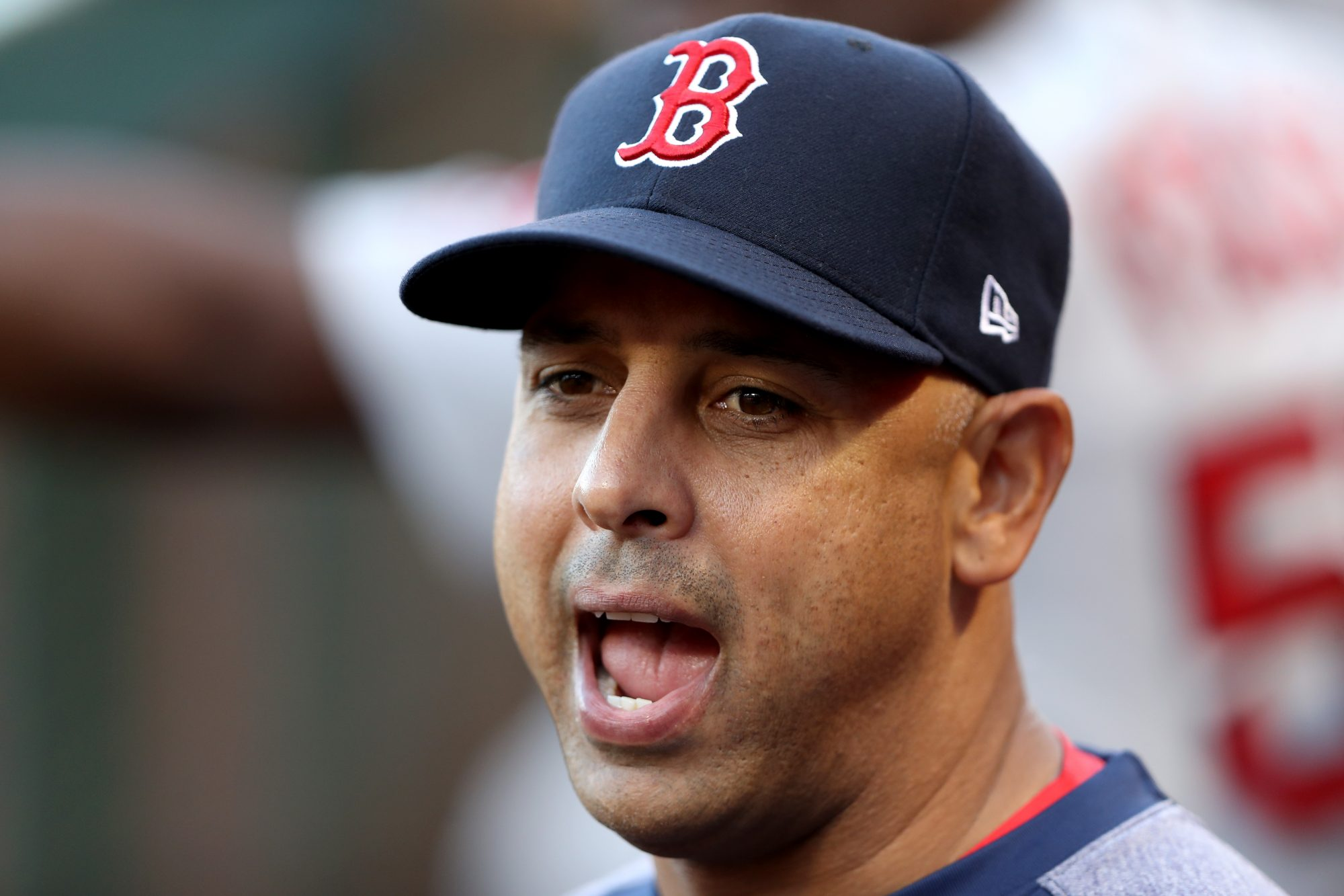 Alex Cora makes a stupid face as manager of the Boston Red Sox, back before he was fired for being a cheater.