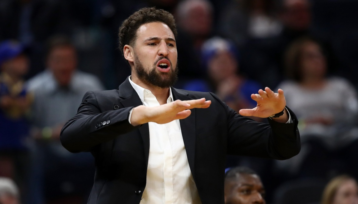 SAN FRANCISCO, CALIFORNIA - NOVEMBER 25: Injured Klay Thompson #11 of the Golden State Warriors reacts on the bench after the Warriors made a basket against the Oklahoma City Thunder at Chase Center on November 25, 2019 in San Francisco, California. NOTE TO USER: User expressly acknowledges and agrees that, by downloading and or using this photograph, User is consenting to the terms and conditions of the Getty Images License Agreement. (Photo by Ezra Shaw/Getty Images)