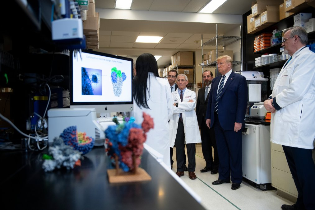 National Institute of Allergy and Infectious Diseases Director Tony Fauci (C) looks on next to US President Donald Trump during a tour of the National Institutes of Health's Vaccine Research Center March 3, 2020, in Bethesda, Maryland