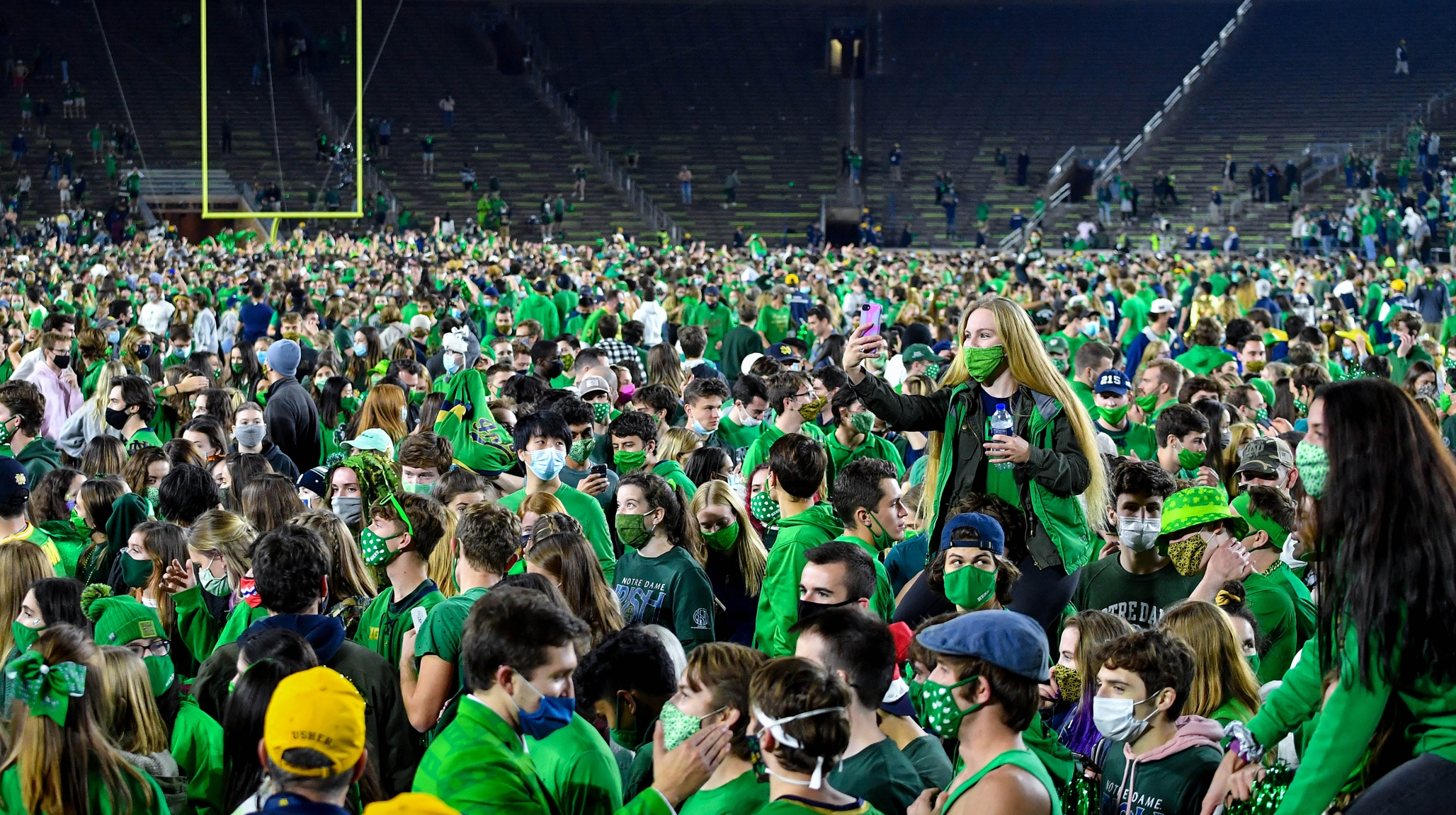 Fans storm the field after the Notre Dame Fighting Irish defeated the Clemson Tigers 47-40 in double overtime at Notre Dame Stadium on November 7, 2020