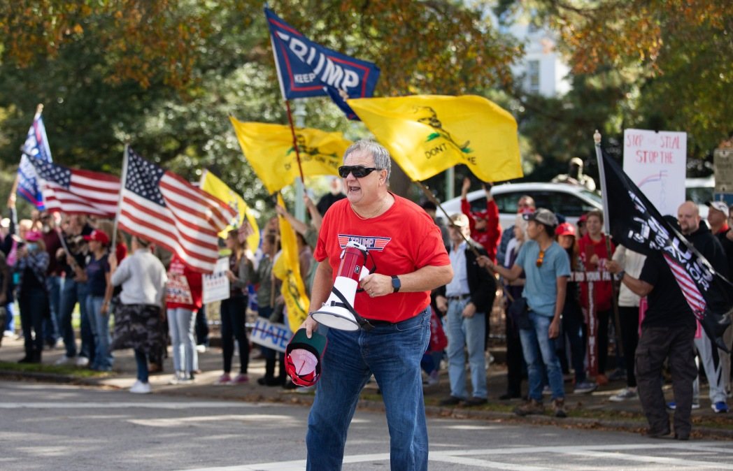 Supporters of US President Donald Trump rally to protest results from the 2020 Presidential election in Raleigh, North Carolina, on November 14, 2020. - Trump supporters are rallying across the country to protest what the the President is calling rampant election fraud perpetrated by the Democratic Party to steal the election. (Photo by Logan Cyrus / AFP) (Photo by LOGAN CYRUS/AFP via Getty Images)