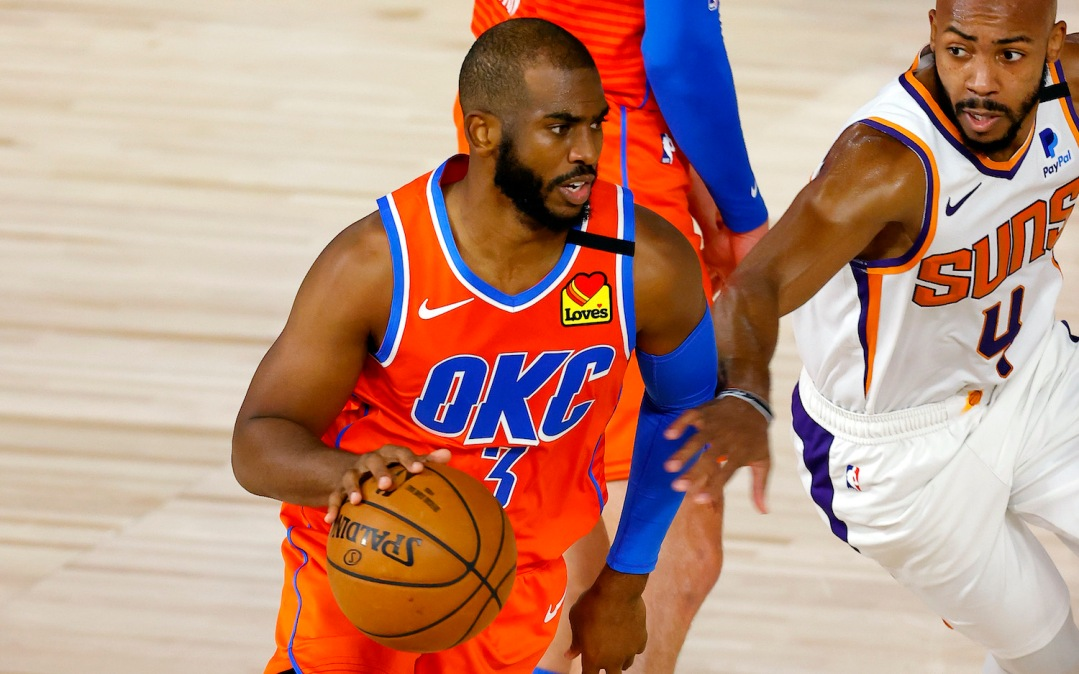 LAKE BUENA VISTA, FLORIDA - AUGUST 10: Chris Paul #3 of the Oklahoma City Thunder is pressured by Jevon Carter #4 of the Phoenix Suns during the second quarter at The Field House at ESPN Wide World Of Sports Complex on August 10, 2020 in Lake Buena Vista, Florida. NOTE TO USER: User expressly acknowledges and agrees that, by downloading and or using this photograph, User is consenting to the terms and conditions of the Getty Images License Agreement. (Photo by Mike Ehrmann/Getty Images)