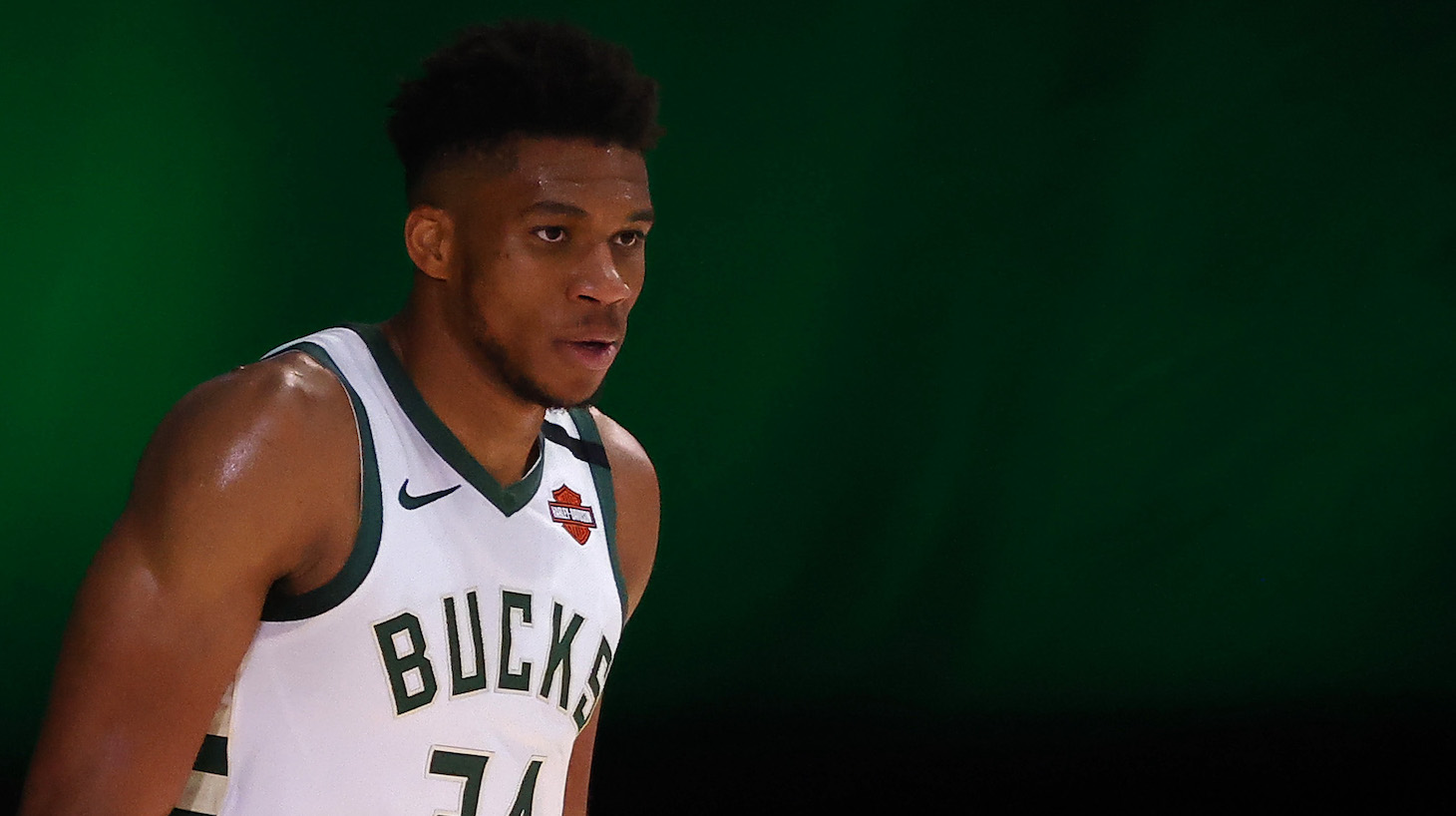 LAKE BUENA VISTA, FLORIDA - AUGUST 29: Giannis Antetokounmpo #34 of the Milwaukee Bucks looks on against the Orlando Magic during the third quarter in Game Five of the Eastern Conference First Round during the 2020 NBA Playoffs at AdventHealth Arena at ESPN Wide World Of Sports Complex on August 29, 2020 in Lake Buena Vista, Florida. NOTE TO USER: User expressly acknowledges and agrees that, by downloading and or using this photograph, User is consenting to the terms and conditions of the Getty Images License Agreement. (Photo by Kevin C. Cox/Getty Images)