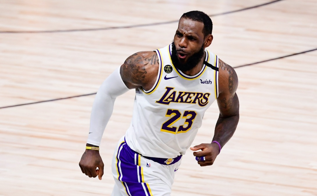 LAKE BUENA VISTA, FLORIDA - OCTOBER 11: LeBron James #23 of the Los Angeles Lakers reacts during the fourth quarter against the Miami Heat in Game Six of the 2020 NBA Finals at AdventHealth Arena at the ESPN Wide World Of Sports Complex on October 11, 2020 in Lake Buena Vista, Florida. NOTE TO USER: User expressly acknowledges and agrees that, by downloading and or using this photograph, User is consenting to the terms and conditions of the Getty Images License Agreement. (Photo by Douglas P. DeFelice/Getty Images)