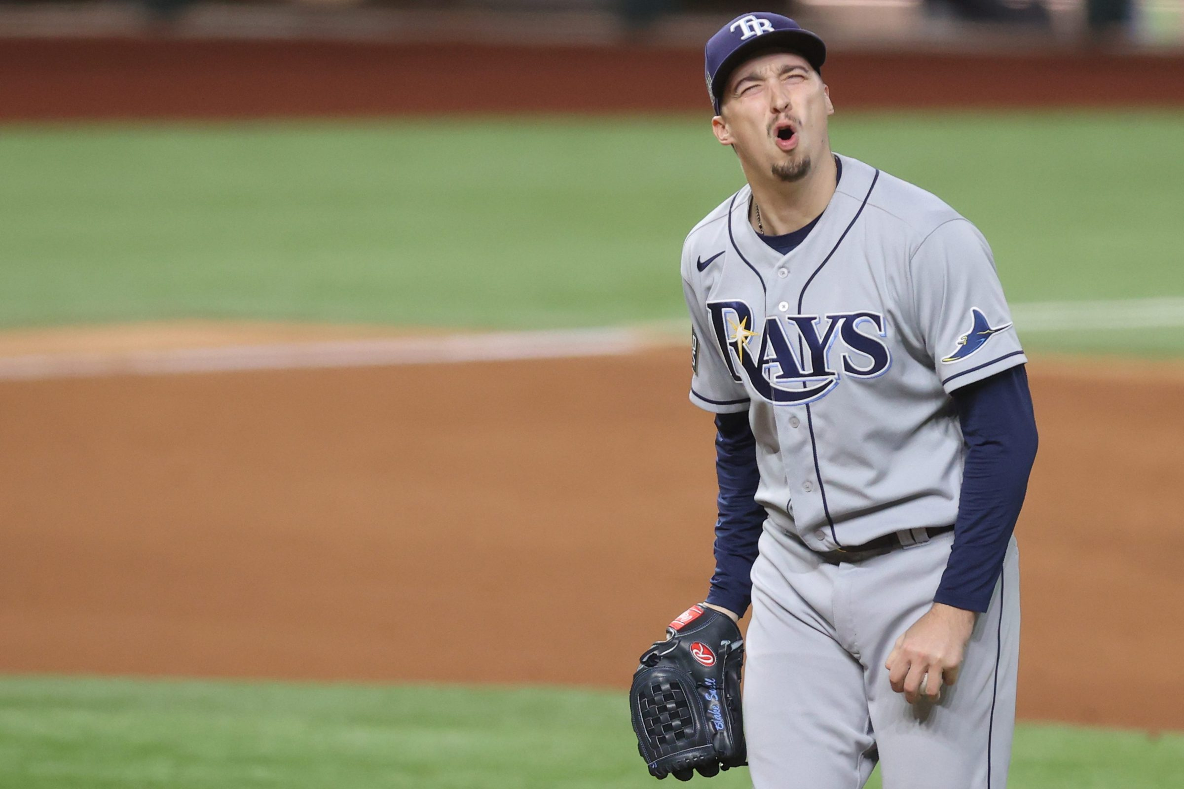 Blake Snell #4 of the Tampa Bay Rays reacts as he is being taken out of the game