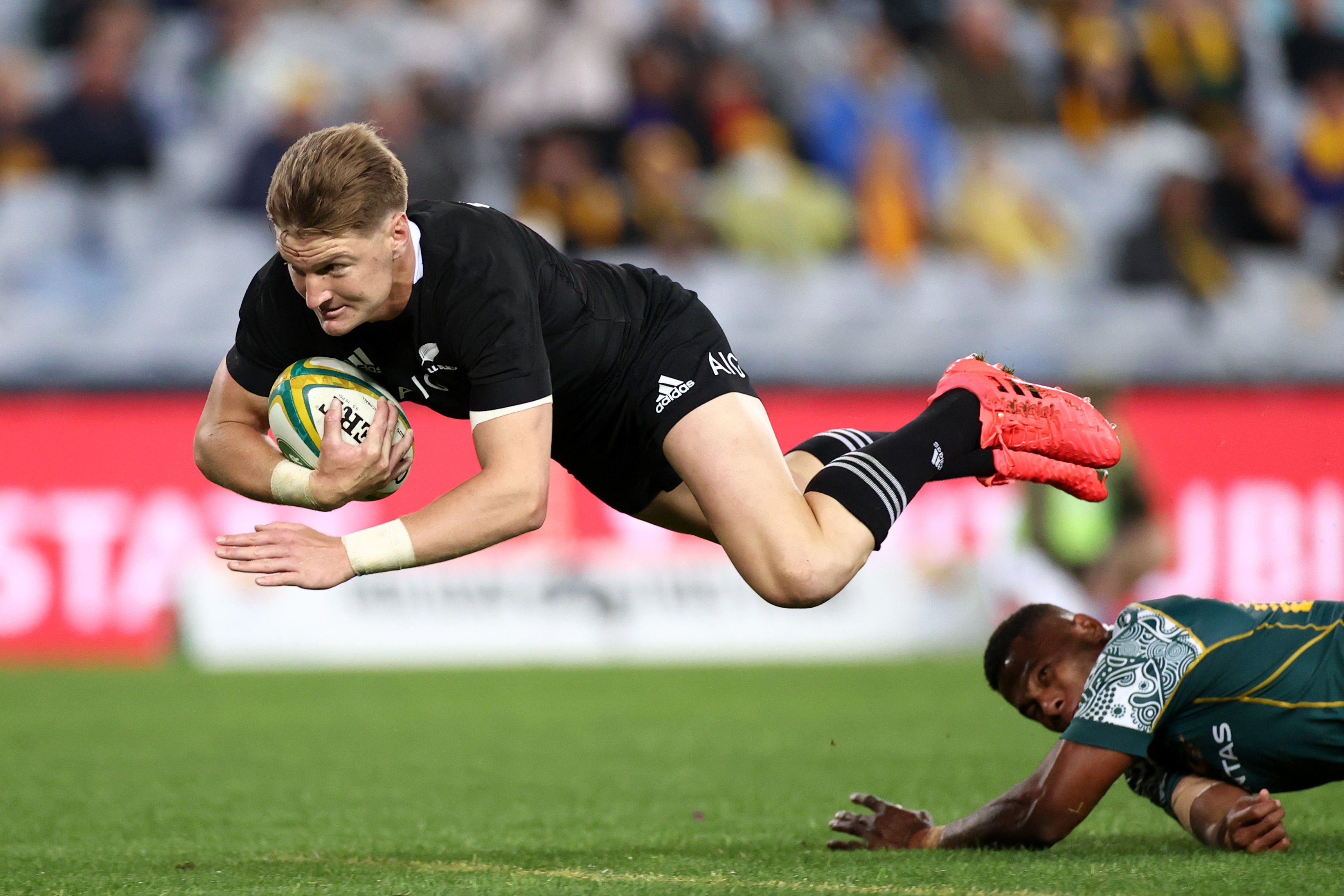 Jordie Barrett of the All Blacks dives over to score a try