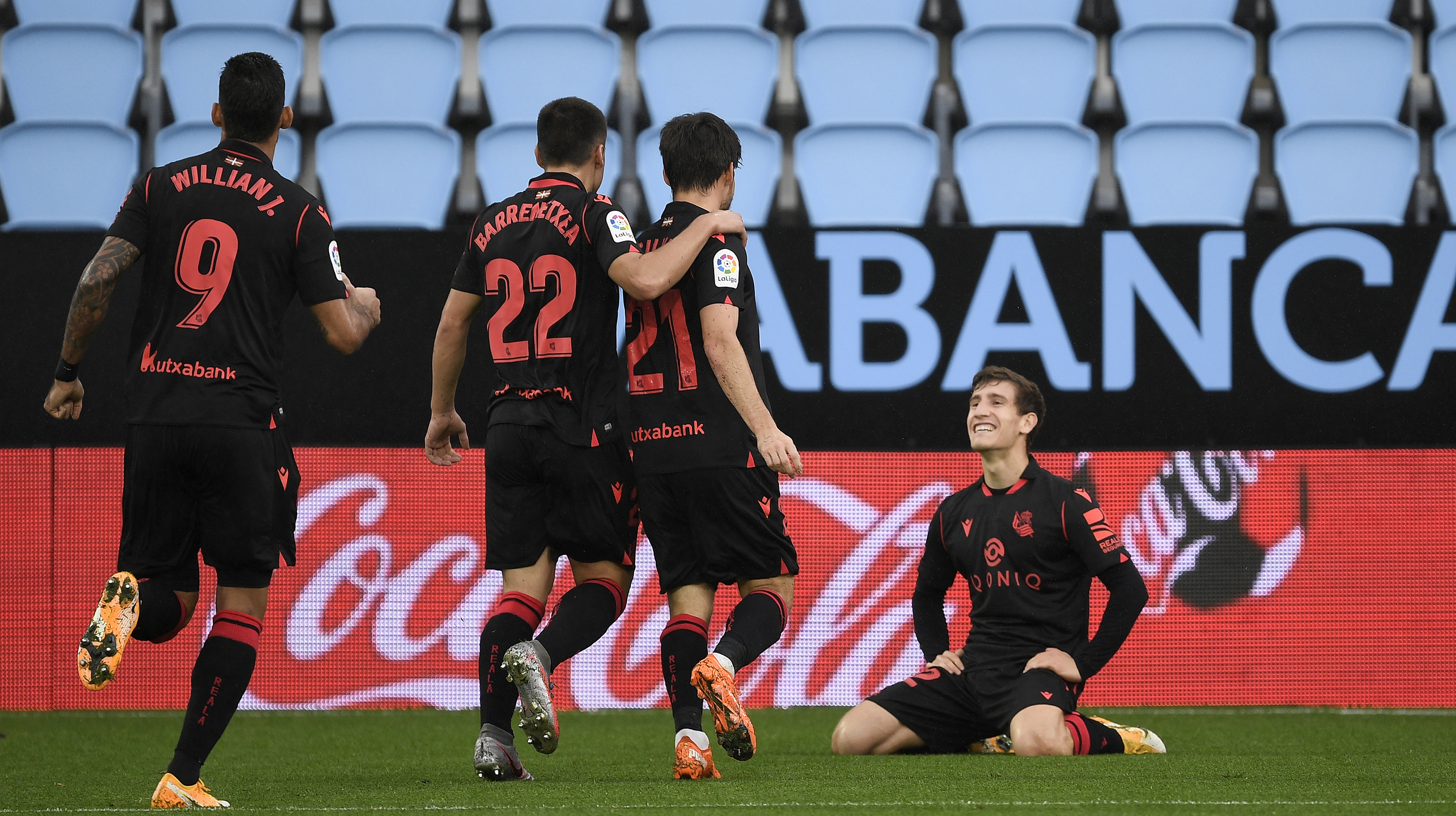 David Silva of Real Sociedad celebrates with teammates after scoring his sides first goal during the La Liga Santader match between RC Celta and Real Sociedad