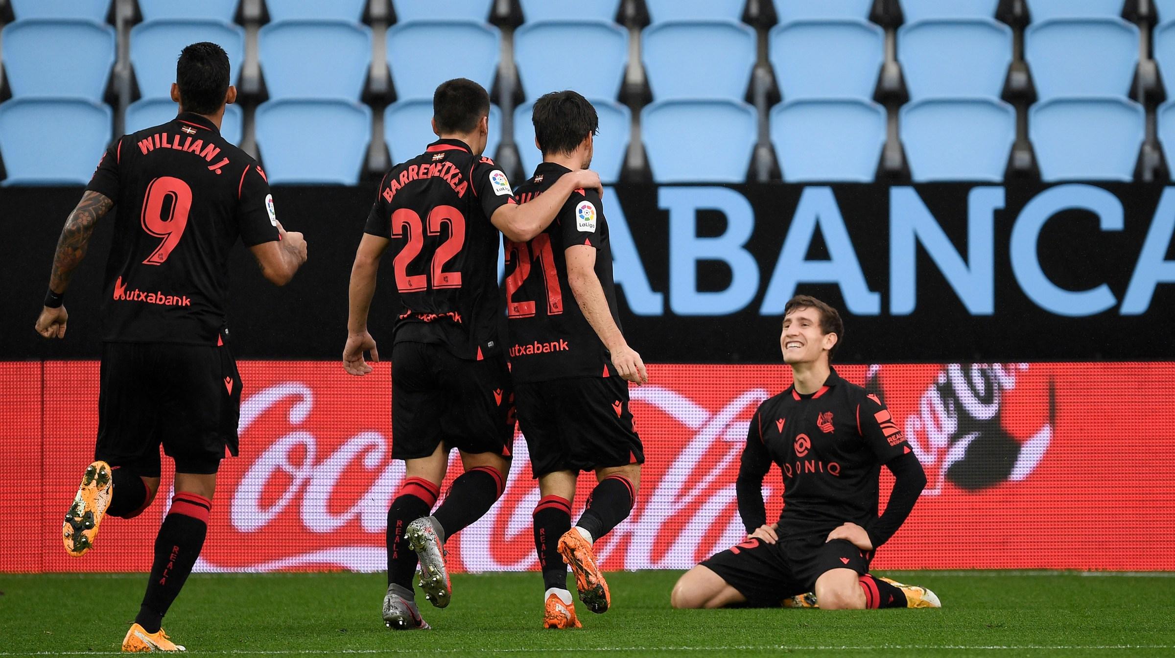 David Silva of Real Sociedad celebrates with teammates after scoring his sides first goal during the La Liga Santader match between RC Celta and Real Sociedad