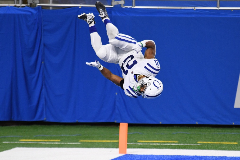 Colts player Nyheim Hines is caught suspended upside down during one of his touchdown celebration flips