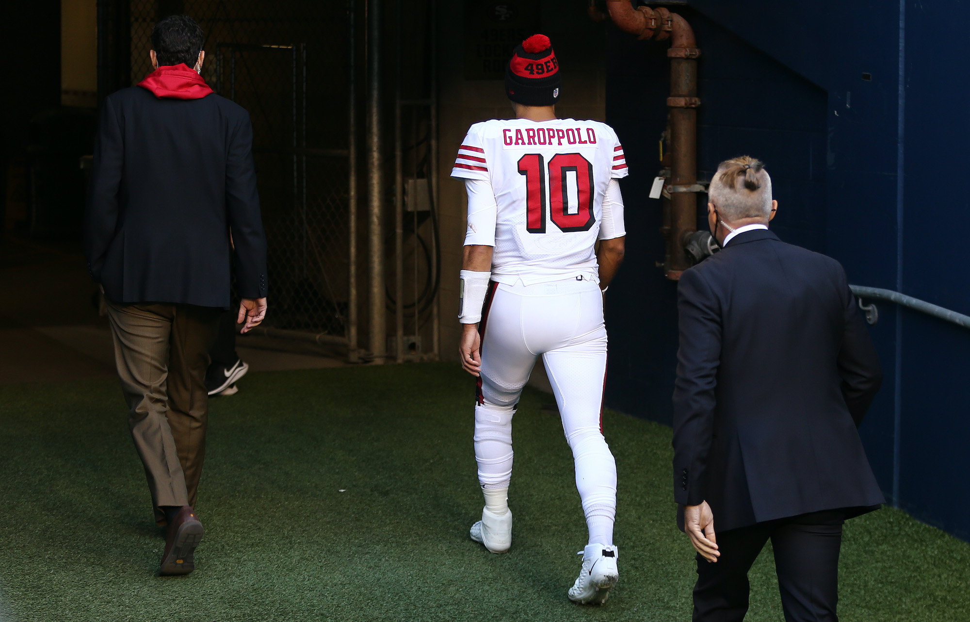 SEATTLE, WASHINGTON - NOVEMBER 01: Quarterback Jimmy Garoppolo #10 of the San Francisco 49ers exits the field as they play the at the start of the fourth quarter of the game at CenturyLink Field on November 01, 2020 in Seattle, Washington. (Photo by Abbie Parr/Getty Images)