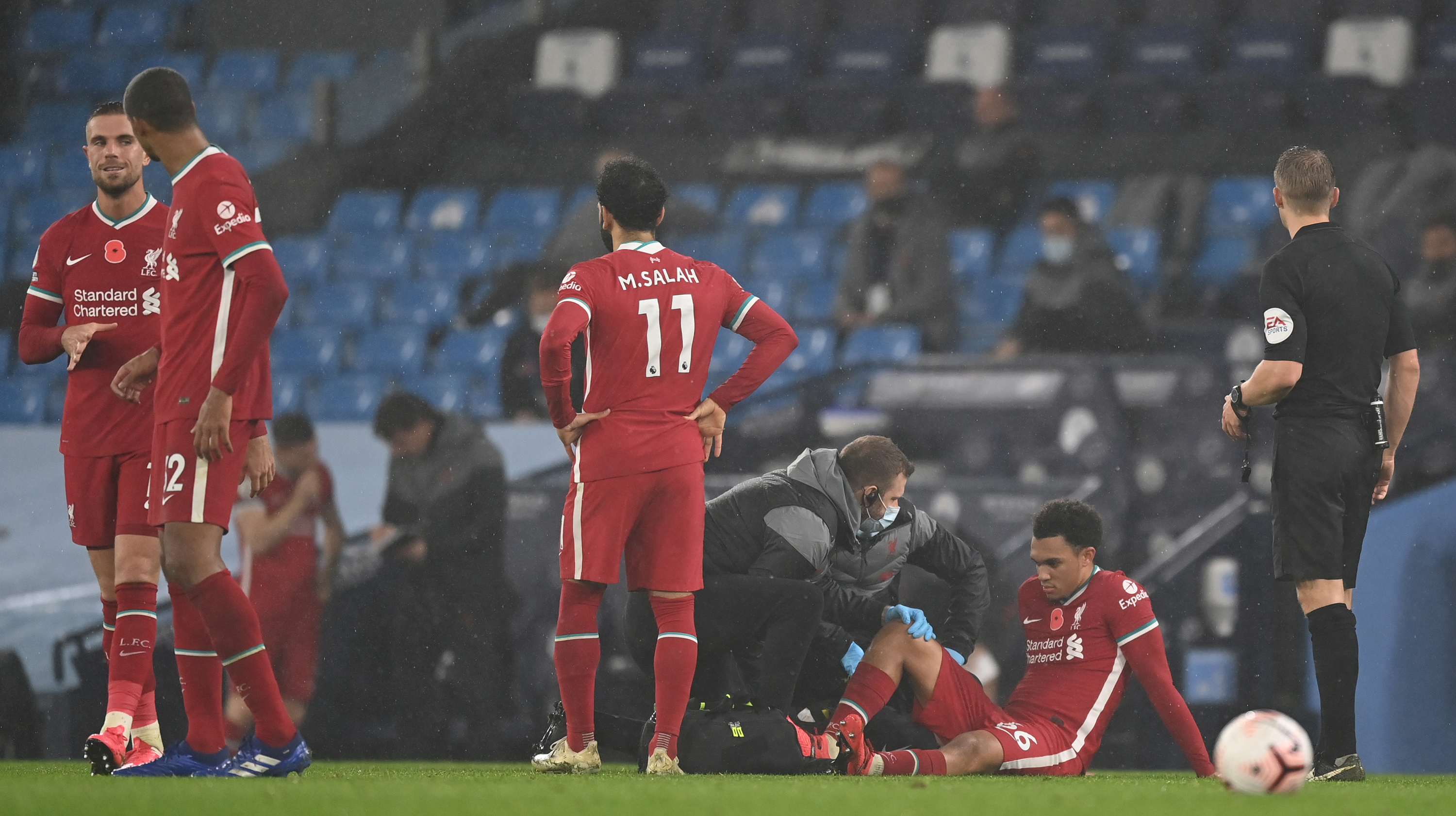 Trent Alexander-Arnold of Liverpool receives medical treatment during the Premier League match between Manchester City and Liverpool at Etihad Stadium on November 08, 2020