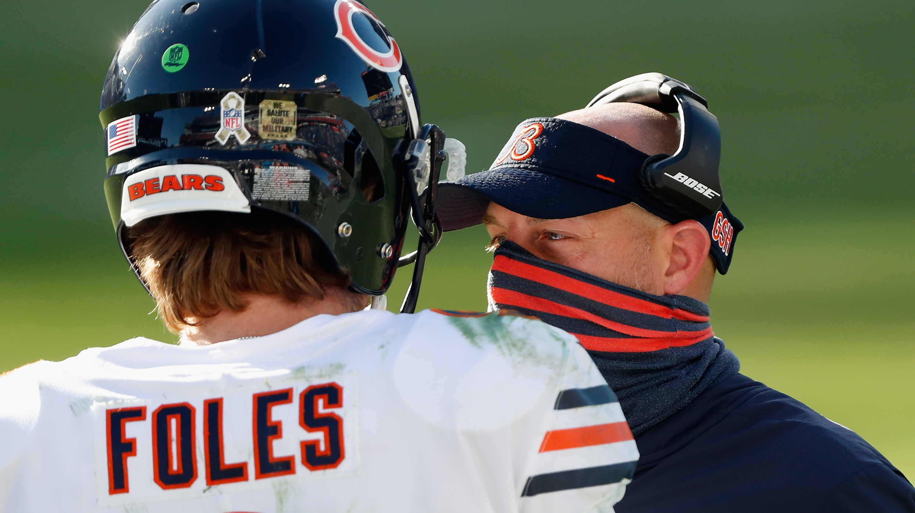 Head coach Matt Nagy of the Chicago Bears talks with quarterback Nick Foles #9 during the third quarter against the Tennessee Titans at Nissan Stadium on November 08, 2020 in Nashville, Tennessee.