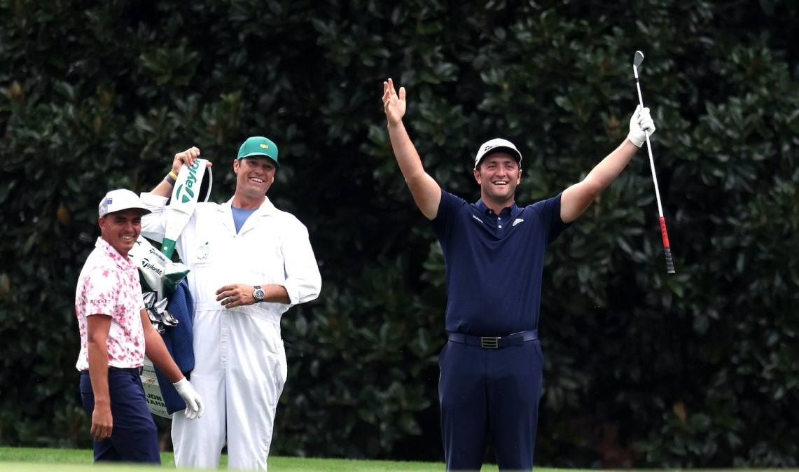 AUGUSTA, GEORGIA - NOVEMBER 10: Jon Rahm of Spain celebrates with Rickie Fowler of the United States after skipping in for a hole in one on the 16th during a practice round prior to the Masters at Augusta National Golf Club on November 10, 2020 in Augusta, Georgia. (Photo by Rob Carr/Getty Images)