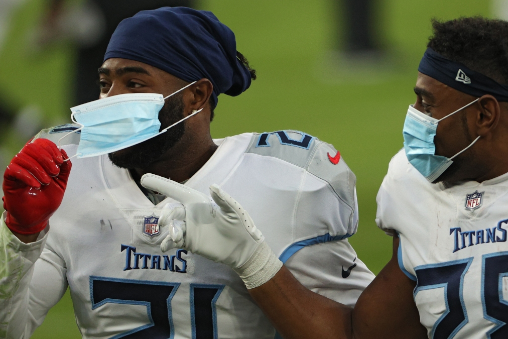 Two Titans players wear masks