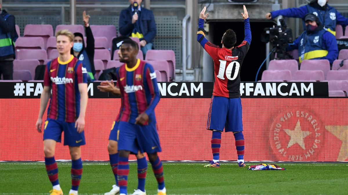 Lionel Messi of Barcelona celebrates after scoring their sides fourth goal while wearing a Newell's Old Boys shirt with the number 10 on the back in memory of former footballer, Diego Maradona, who recently passed away during the La Liga Santander match between FC Barcelona and C.A. Osasuna at Camp Nou on November 29, 2020 in Barcelona, Spain. Sporting stadiums around Spain remain under strict restrictions due to the Coronavirus Pandemic as Government social distancing laws prohibit fans inside venues resulting in games being played behind closed doors.