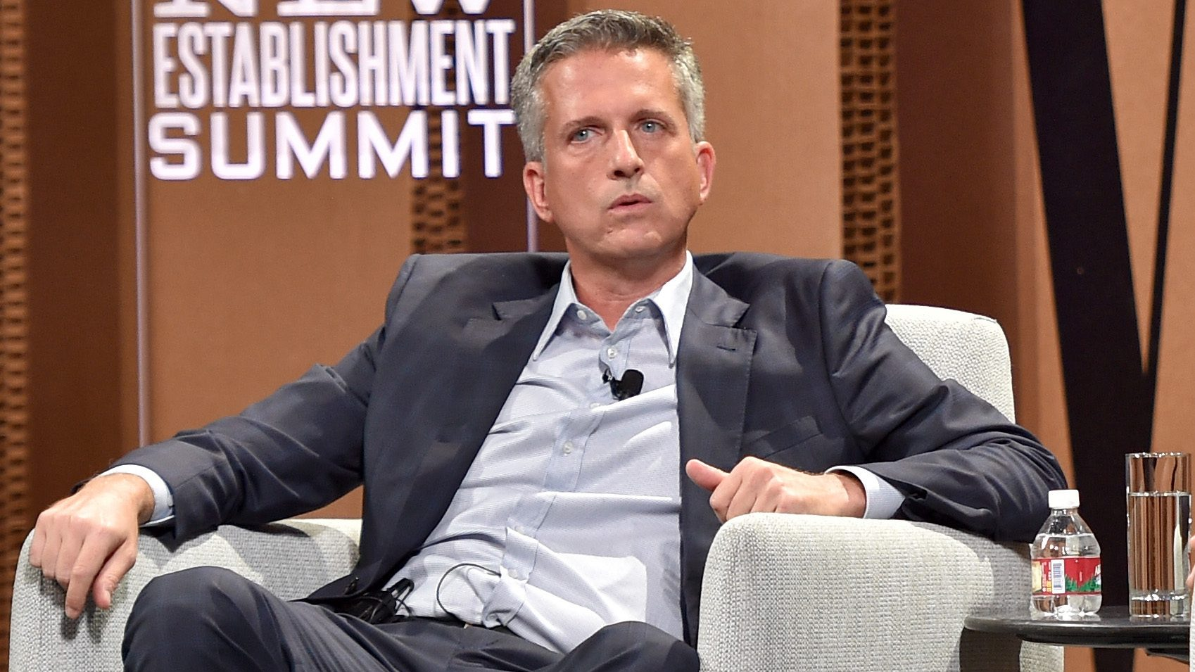 Bill Simmons sits in an armchair looking like an asshole